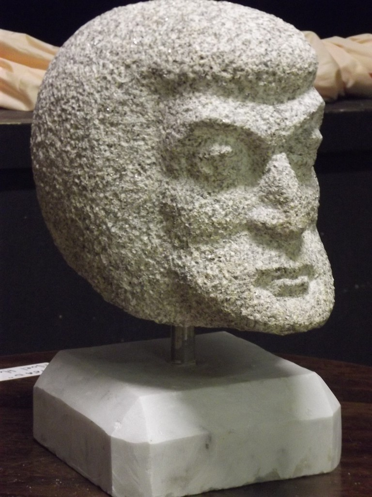 Ancestral, Head Granite. A small head on a simple marble base.