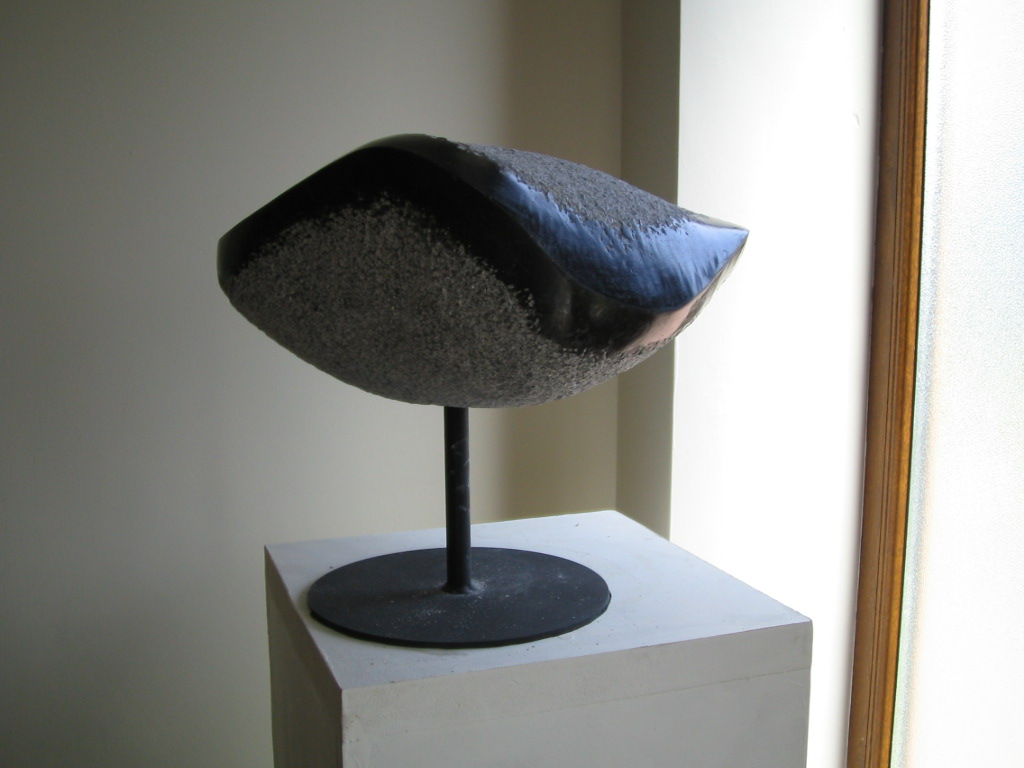 Asteroid, Limestone. Highly polished and mounted on metal up right and stand.