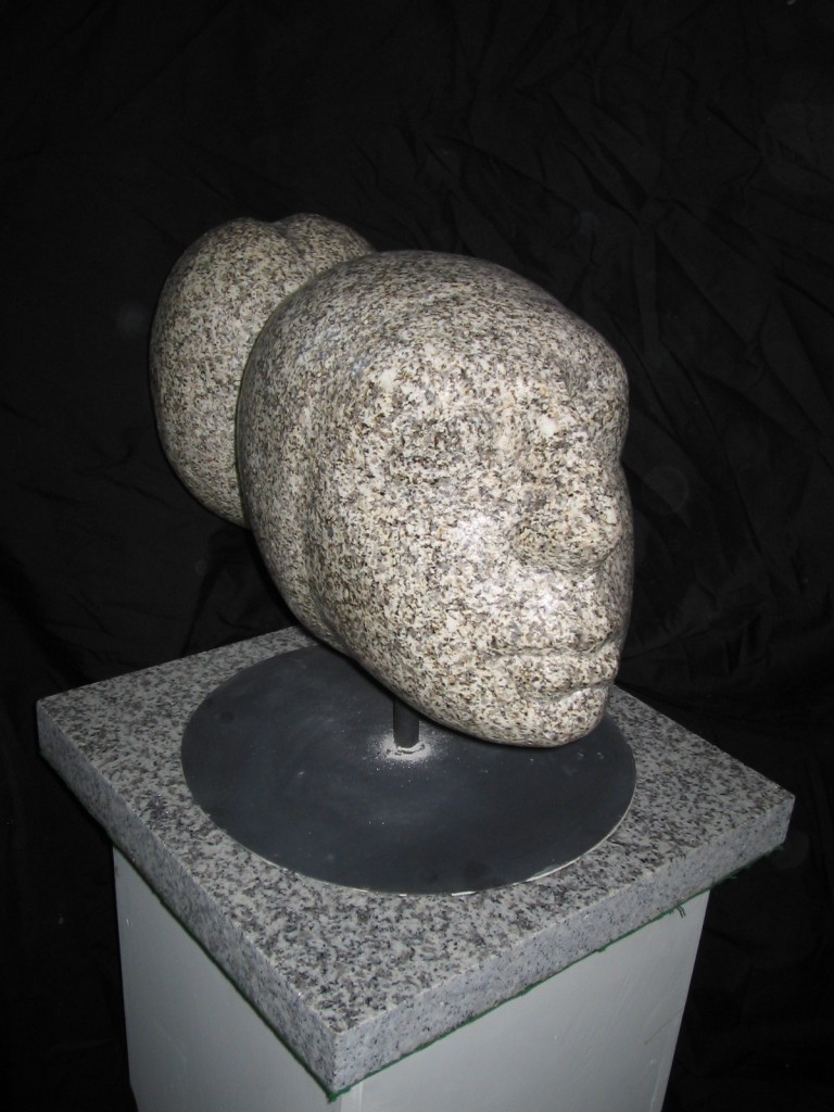 Deirdre. Granite. Simple polished head on metal base. Inspired by artist's daughter.