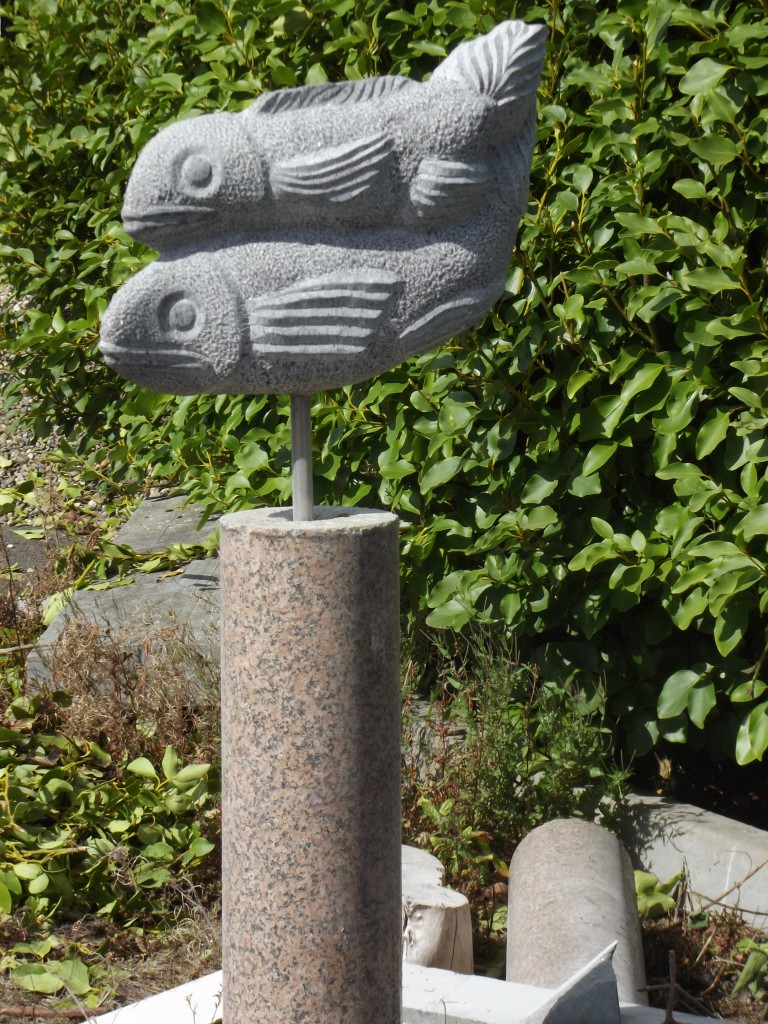 Fish Pair. Limestone on a red granite base.