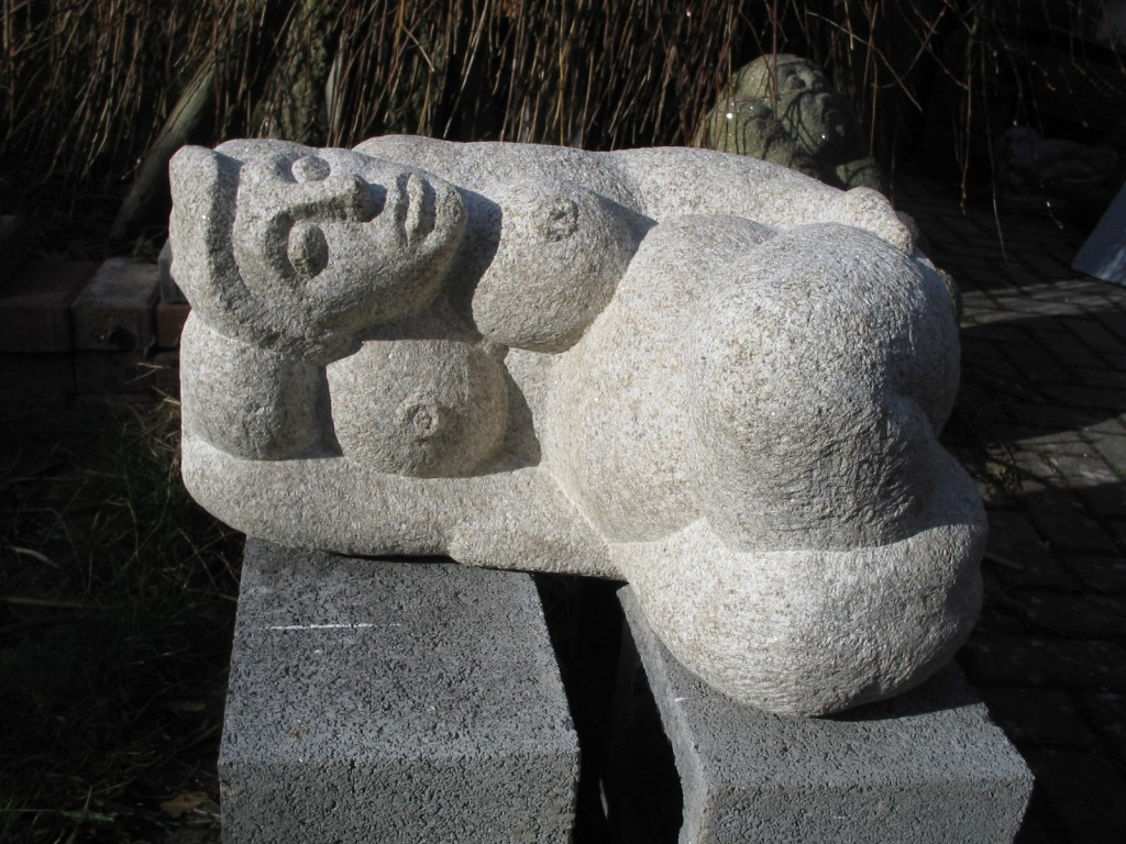 Reclining nude. Granite. A medium sized piece, suitable for outdoors,