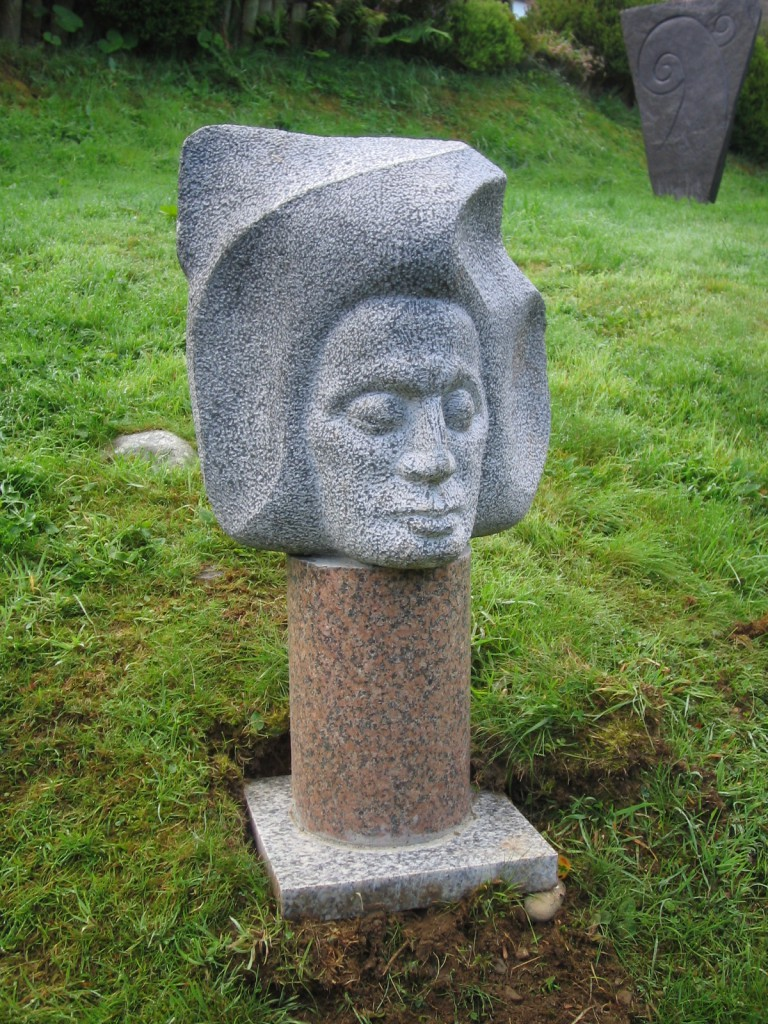 Icarus. Limestone. Inspired by the story of Icarus. This piece is mounted on Red Granite and is suitable for the garden.