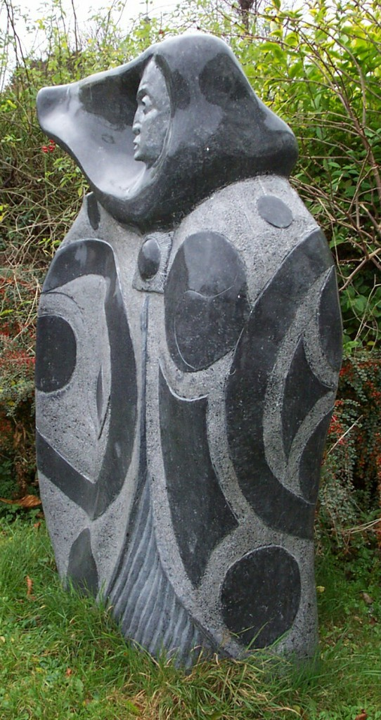 Meave standing figure - limestone - Carved in Irish limestone, in Dublin. Female figure with cloak, decorated with Celtic design. Polished and textured finish.