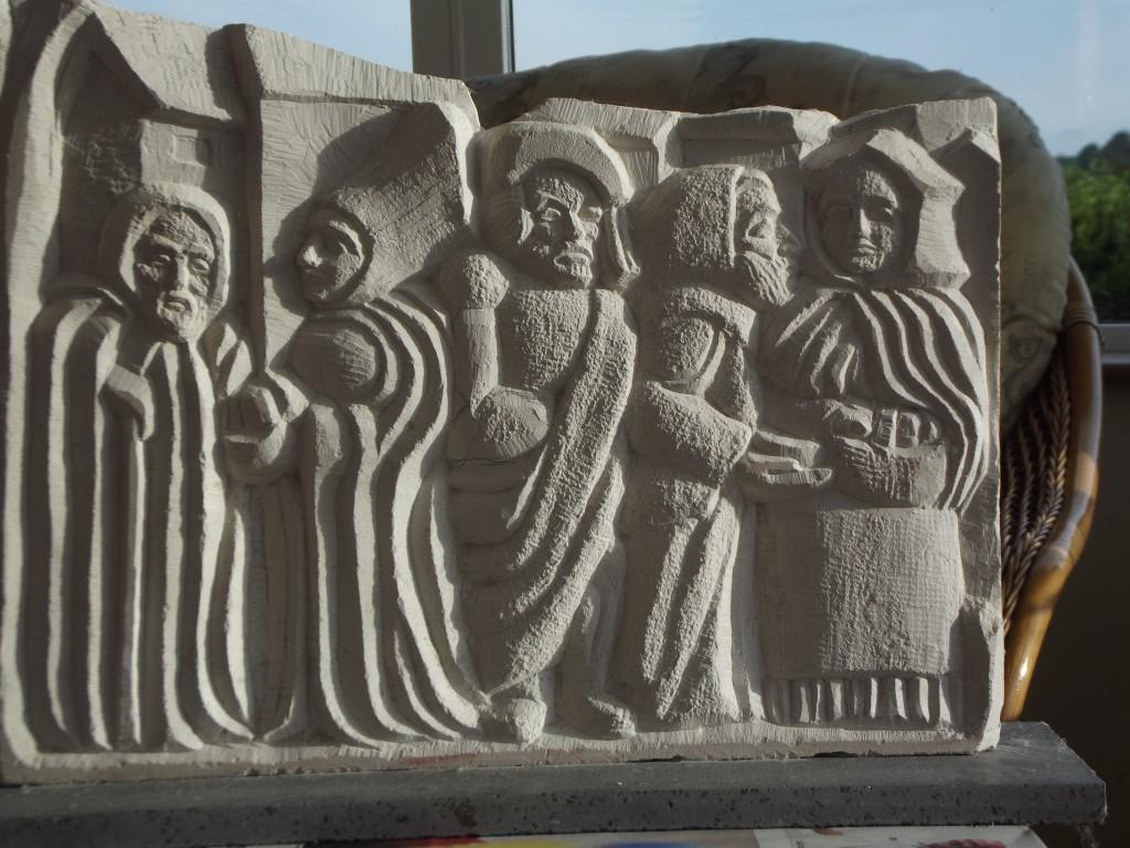 Medieval Town Scene. Sandstone relief.