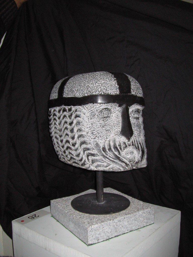 Norman Head. Limestone. Small head mounted on a metal stand.