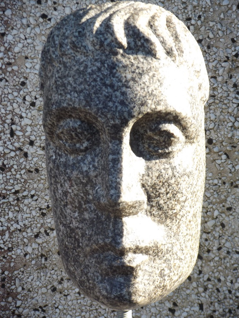 Roman Head. Granite. A head fragment inspired by the Classical period.