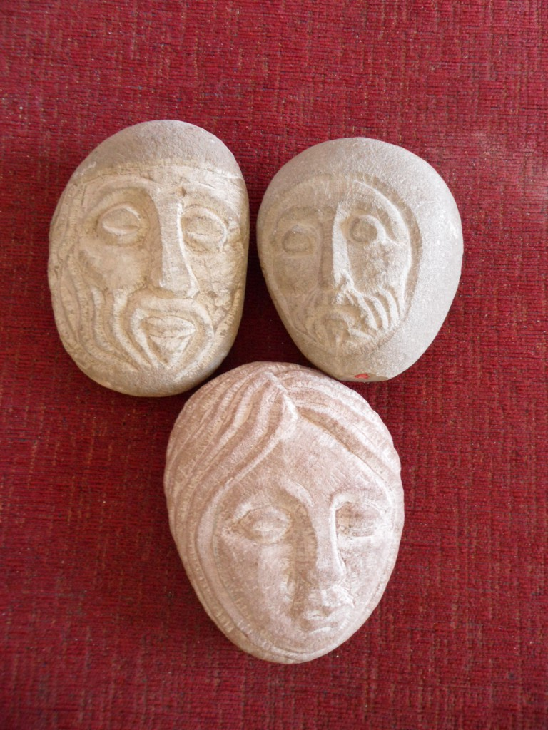 Small village Medieval heads. Sandstone.