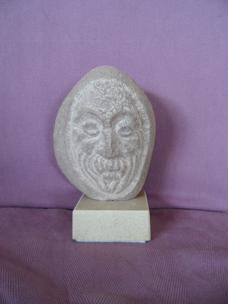 Small Medieval head. Sandstone.