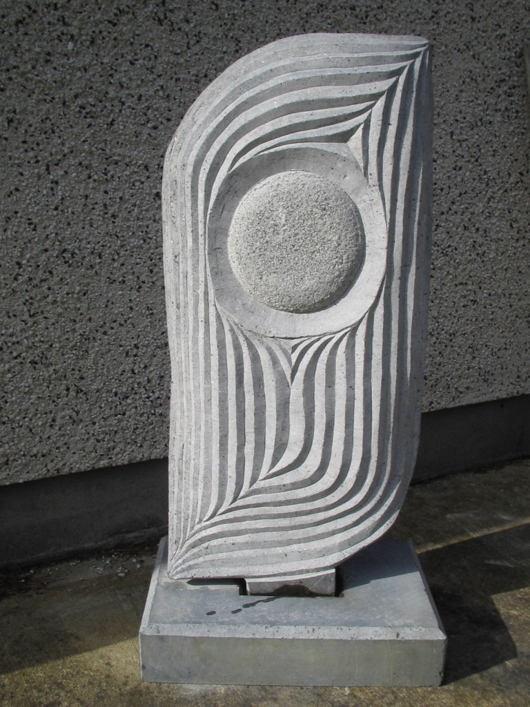 Space Opus 2. Limestone. Simple upright abstract garden sculpture.