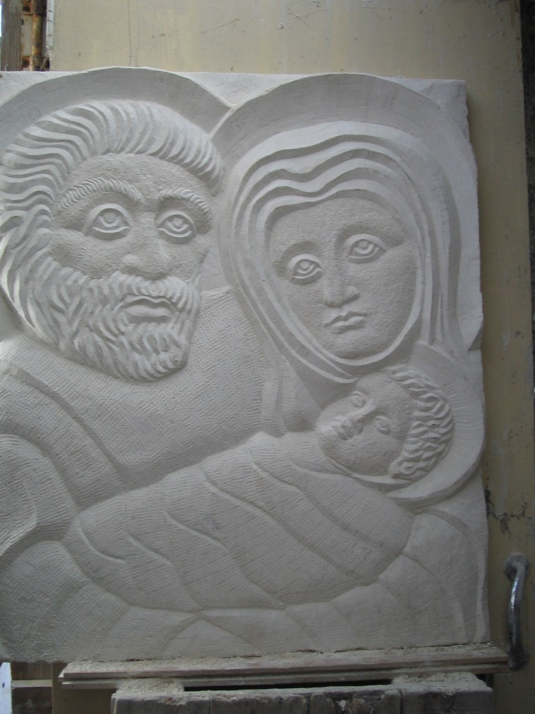 Holy Family - stone - Carved in Portugese limestone, in Dublin. Depicts the Holy Family in a medieval style.