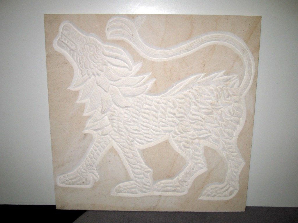 Wolf panel. White Limestone relief.